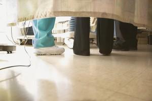 Doctors and nurses feet under curtain