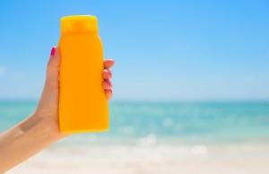 bigstock-Woman-holding-sunscreen-bottle-88434743-300x200